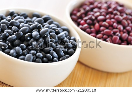 Dry black and red adzuki beans in bowls