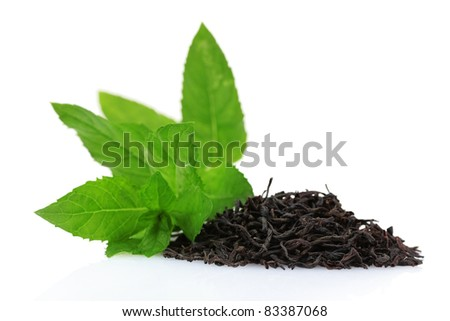 dry black tea leaves and mint isolated on white
