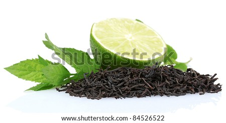 dry black tea leaves, lime and mint isolated on white