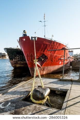 Dry cargo ships docked at Quay Lieutenant Schmidt in St. Petersburg