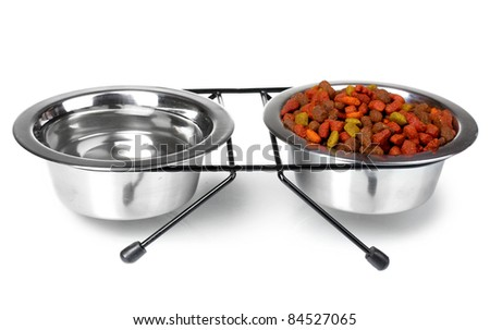 Dry cat food and water in bowls isolated on white