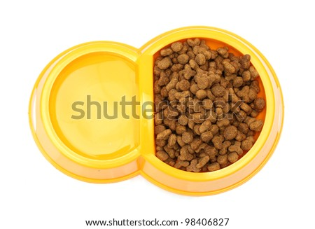 dry cat food and water in yellow bowl isolated on white - stock photo