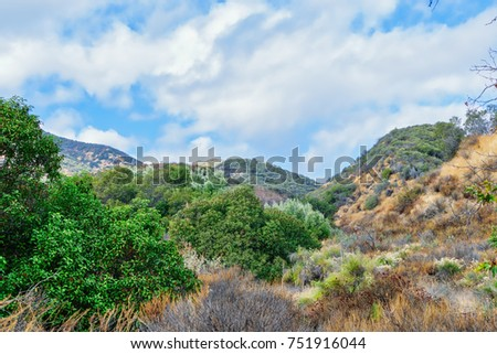 Shutterstock Dry chaparral along hiking trail in California mountains