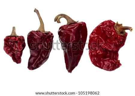 Dry chili peppers isolated on white background