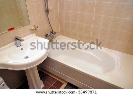 Dry, clean bathtub and wash basin in a luxurious hotel room