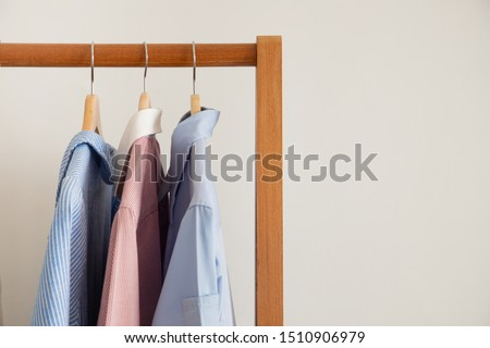 dry clothes hang on clothes rack.