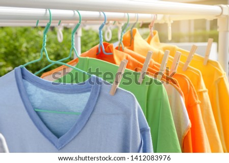 Dry clothes in bright colors in the sun.