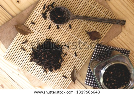 Dry clove and dry clove spicee on chopping.Top view #1319686643