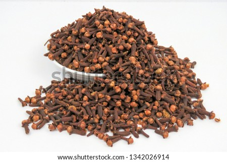 Dry Cloves. Cloves are the aromatic flower buds of a tree in the family Myrtaceae, Syzygium aromaticum. They are native to the Maluku Islands (or Moluccas) in Indonesia. #1342026914