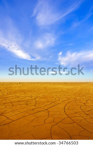 Dry crack field at sunset time