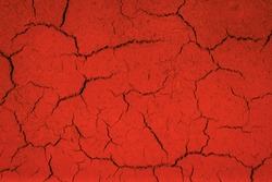 Dry, cracked soil surface in lush lava color