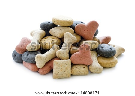 dry dog biscuits in a heap isolated on white
