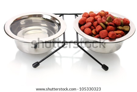 dry dog food and water in metal bowls isolated on white