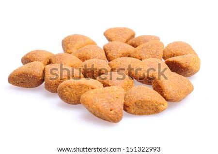Dry dog food close up, isolated on white background