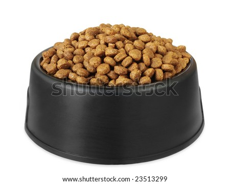 Dry dog food in a black dog dish, isolated on white.