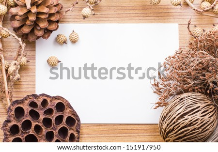 Dry flowers frame on white paper background with copy space