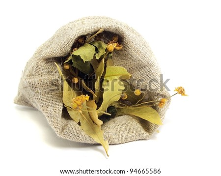 dry flowers of linden tree in sack on a white background