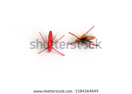 Dry fly fly fishing, closeup on white background.