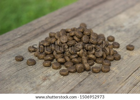 Dry food for animals in granules on a table