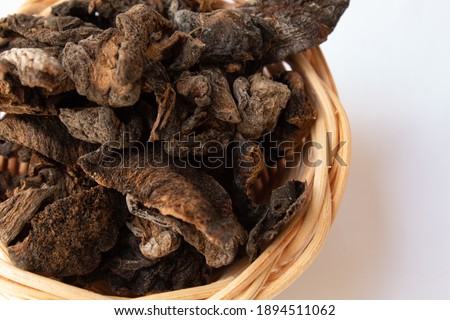 Dry funghi mushroom in small wicker basket, isolated on white background Foto d'archivio ©