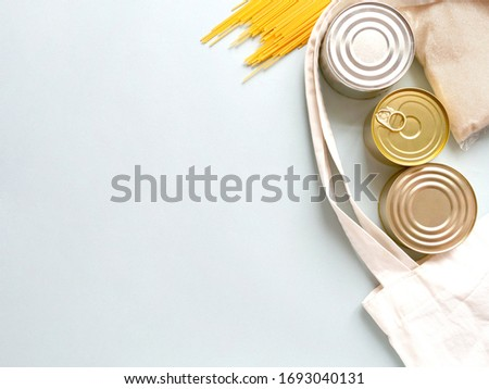 Dry goods, stockpiling, food supplies for staying home concept. Preserves, pasta, oatmeal, sugar, bag on blue background, copyspace Stock fotó ©