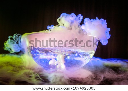 Dry ice in the jar. Steam from dry ice. Dry ice bubbles in the water. Evaporation of dry ice.