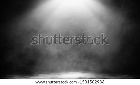 Dry ice smoke clouds fog floor texture.Perfect spotlight mist effect on isolated black background.. stock photo