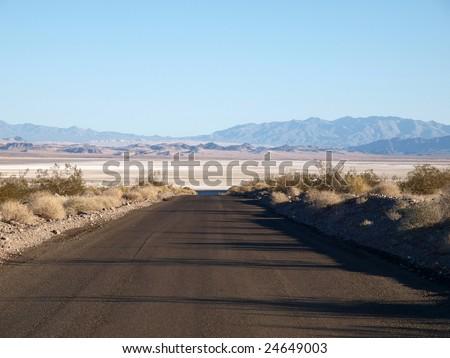 Dry lake and road in California's Mojave Desert.