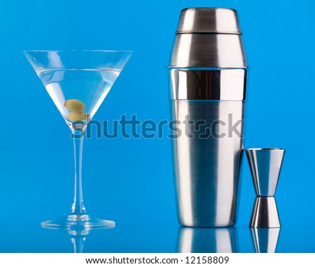 Dry Martini, Shaker and Measure glass over colorful blue background