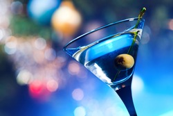 dry martini with olives ,focus on a berry