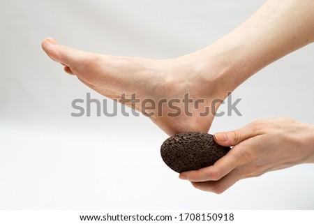 dry massage with a pumice stone.  foot care Stockfoto ©