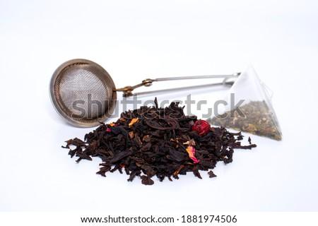 dry natural tea and packaged tea, boiling strainer. the concept of making tea. Stock photo ©