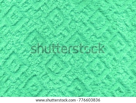 Dry new luxury light emerald teal plain color wrinkled grainy woolen body spa towel with volume square rhombus fur even fond design. Close-up macro top detail rug view with space for text #776603836