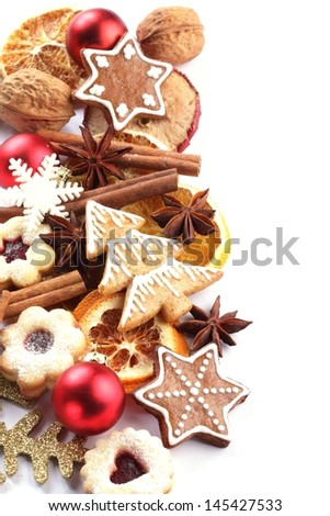 Dry orange and apple slices, spices and Christmas cookies on white background.