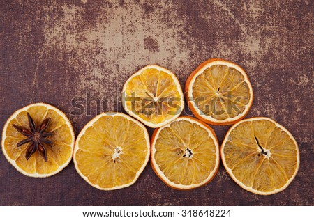 Dry oranges slices with aniseed on shabby chic surface #348648224