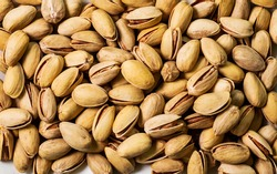 Dry organic Pistachio Roasted Salted top view background or texture. Healthy spices, nuts, seeds and herbal products.