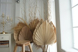 Dry palm leaf and dry pampas in big and small rope vase. Studio photo decoration.
