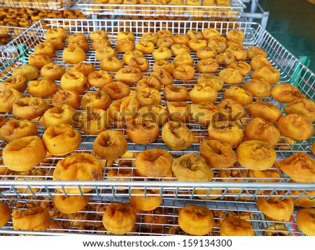 Dry persimmons. Traditional Taiwan persimmon snack and food. A spread view of gold fruit background.