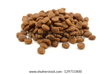 Dry pet food in kibble form on white background
