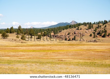 dry plains and forested mountains - stock photo
