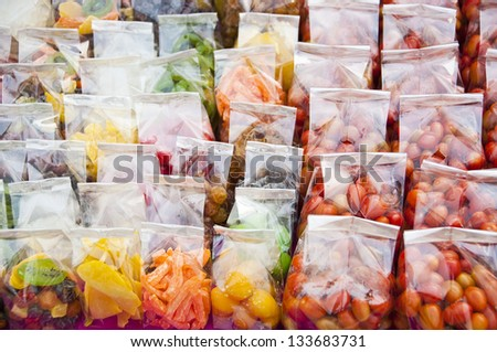 Dry preserved fruit in plastic bag.