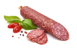 Dry sausage or salami with basil and spices, close-up, isolated on white background.
