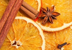 Dry slices of orange, cinnamon, cloves and cardamom