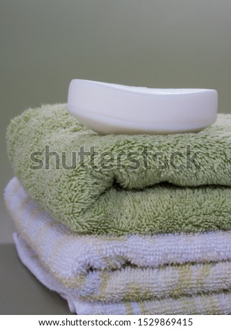 Dry soap bar place over nice bath towels