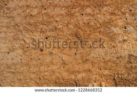 Dry soil texture and background. Brown soil background. Abstract ground. Natural abstraction. Cracked soil background. Clay. Ocher #1228668352