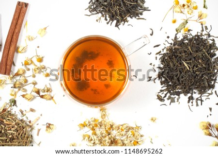 dry tea and herbs scattered on a white background  #1148695262