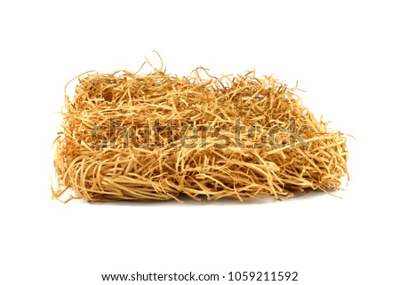 Dry yellow hay stack. Haystack grass on white isolated background. #1059211592