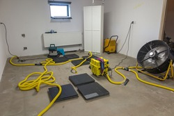 Drying a concrete floor under a fabric covering. After pouring, initial drying, and then drilling and blowing hot air into the heating zone and drying the outgoing air.