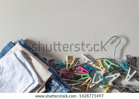 Drying clothes concept. Clothes hanger with clothes and Clothespins