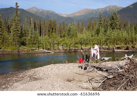 Drying clothes on river bank in pristine wilderness landscape, Big Salmon River, Yukon Territory, Canada